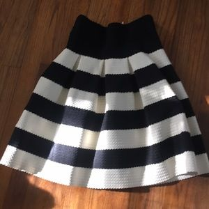 pleated black and white striped high waisted skirt